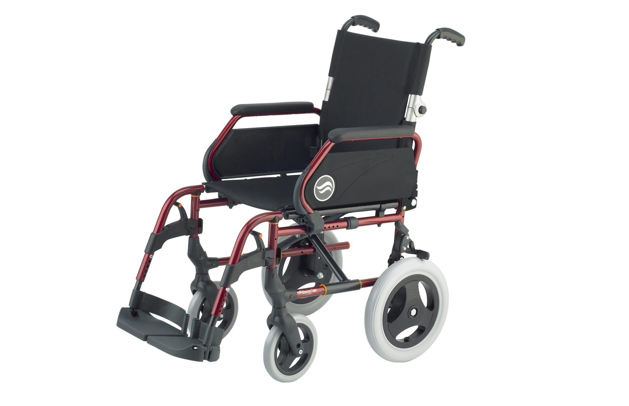 Cadeira de rodas manual, preta com estrutura vermelha, com roda pequena, com vista de perfil.